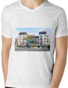 A new Apartment building in Jaffa Israel with a public playground in the foreground  Mens V-Neck T-Shirt