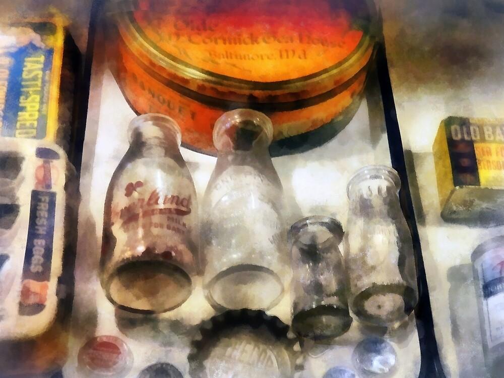 Milk Bottles in Dairy Case by Susan Savad