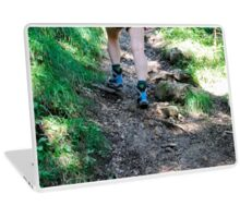 Female hiker hikes in the forest. Close up of the feet and shoes Laptop Skin