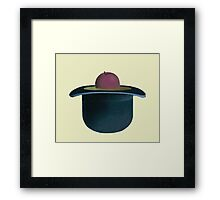 A single plum floating in perfume served in a man's hat Framed Print