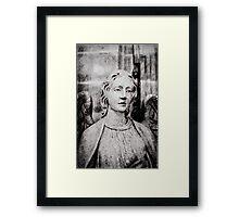 Angel set in stone Framed Print