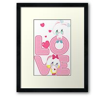 Two cute bunnies on a background of the word LOVE Framed Print