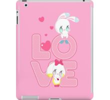 Two cute bunnies on a background of the word LOVE iPad Case/Skin
