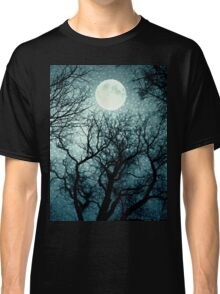 Dark enchanted photo of a full moon in the trees branches background. Blue fairy-tale colors Classic T-Shirt