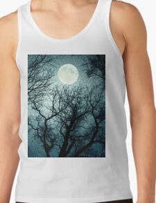Dark enchanted photo of a full moon in the trees branches background. Blue fairy-tale colors T-Shirt