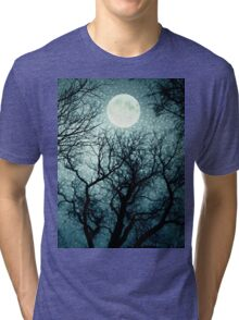 Dark enchanted photo of a full moon in the trees branches background. Blue fairy-tale colors Tri-blend T-Shirt