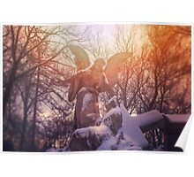 Angel statue illuminated by sunlight. Cemetery during the winter Poster
