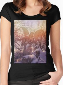 Angel statue illuminated by sunlight. Cemetery during the winter Women's Fitted Scoop T-Shirt