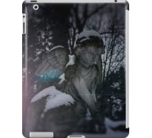 Angel statue illuminated by moonlight. Cemetery during the winter iPad Case/Skin