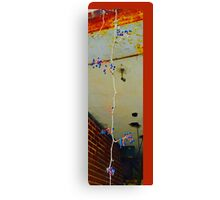 Dangling in the middle of urban decay Canvas Print