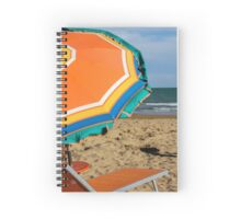 deck chairs on the beach Spiral Notebook