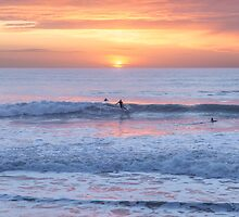 Surfing the sunset waves at Watergate Bay, Cornwall, UK by Zoe Power