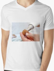 Freshly baked Cream Puffs (Eclairs) being filled with whipped cream.  Mens V-Neck T-Shirt