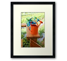Watering cans at a small Organic vegetable patch  Framed Print