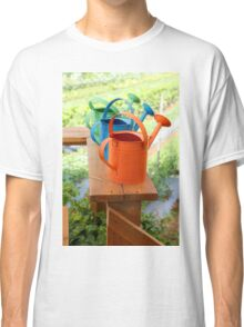 Watering cans at a small Organic vegetable patch  Classic T-Shirt
