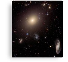 Giant Elliptical Galaxy and its Host Galaxy Cluster. Canvas Print