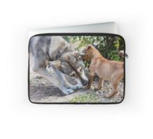A mature dog and a puppy play in the yard  Laptop Sleeve