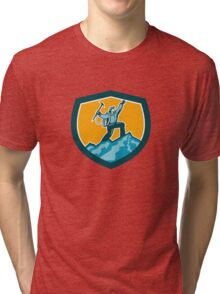Mountain Climber Reaching Summit Retro Shield Tri-blend T-Shirt