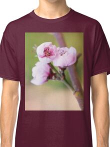 Spring pink cherry blossom with green background Classic T-Shirt