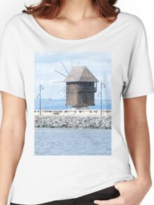 Nesebar, Bulgaria. Landscape with old wooden windmill. Ancient town Nesebar, Bulgaria. Black Sea coast in sunny day Women's Relaxed Fit T-Shirt