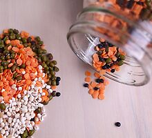 lentils and beans spread on a table top  by PhotoStock-Isra