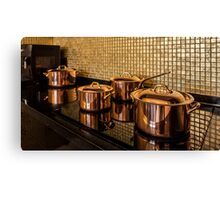 Copper pans on the stove Canvas Print