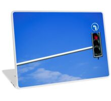 Red light in a left turn traffic light with blue sky background  Laptop Skin