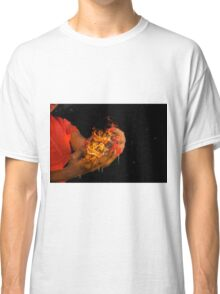 African model with a ball of fire in her hands.  Classic T-Shirt