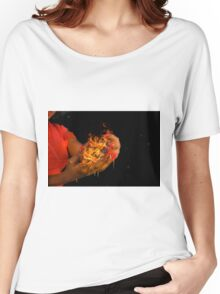 African model with a ball of fire in her hands.  Women's Relaxed Fit T-Shirt