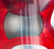 Red headlight of the silver car Sticker