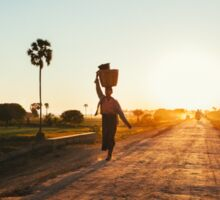 Woman Carrying Baskets on Head Walking in Burmese Countryside at Sunset Sticker