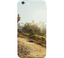 Woman Carrying Baskets on Head Walking in Burmese Countryside in Early Morning iPhone Case/Skin