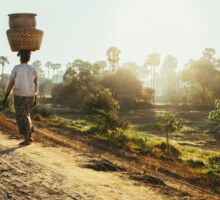 Woman Carrying Baskets on Head Walking in Burmese Countryside in Early Morning Sticker