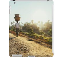Woman Carrying Baskets on Head Walking in Burmese Countryside in Early Morning iPad Case/Skin