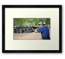 shooter with a shotgun Framed Print