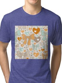 Seamless pattern with bows and hearts. Tri-blend T-Shirt