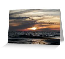 Waves beneath the sunset Greeting Card
