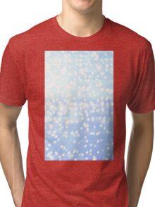 Blue fairy lights sparkly snow bokeh Tri-blend T-Shirt