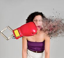 Mechanical boxing devices punches a young woman in the face  by PhotoStock-Isra