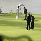 Golfers in the Rain by paulineca