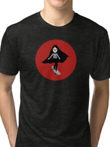 A girl walks home alone at night. Tri-blend T-Shirt