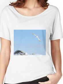 The flight of the snowy owl Women's Relaxed Fit T-Shirt