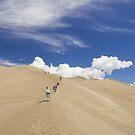 Climbing High Dune by Tamas Bakos
