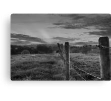 Barbed wire, angry sky.  Canvas Print