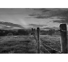 Barbed wire, angry sky.  Photographic Print
