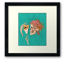 illustration with skull holding a human face mask Framed Print