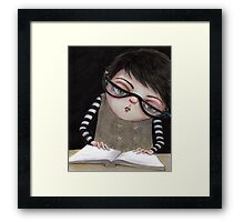 Zoey Reading the Book of Magic Framed Print