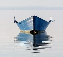 Bow of the boat is reflected in the water by Patrizio Martorana