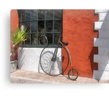 Penny-Farthing in Front of Bike Shop Canvas Print