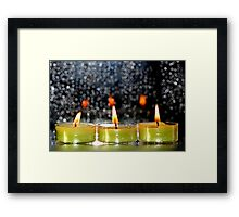 A row of candles Framed Print